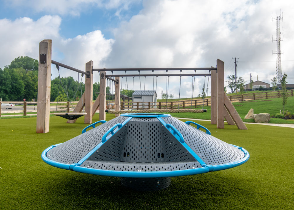 The spinner allows children to whirl around with friends.