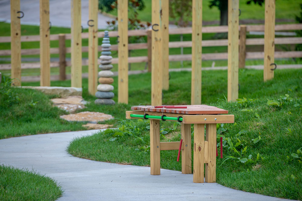 Interactive elements such as the xylophones and water tables are wheelchair height.